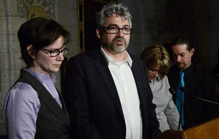 Rehtaeh Parson's father Glen Canning, second from left, speak to reporters in Ottawa on April 23, 2013.
