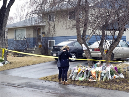 Jill Rogers, right, is comforted by mother Sherrie as they visit the scene of Tuesday's multiple fatal stabbings in northwest Calgary, Alberta on Friday, April 18, 2014.