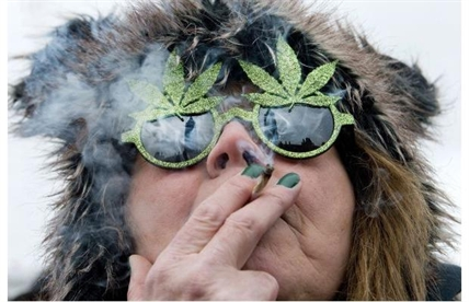 The Peace Tower is reflected in the sunglasses of a woman smoking a joint at the 4/20 rally on Parliament Hill last April 20.