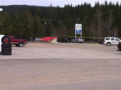 The RCMP Emergency Response Team members can be seen to the left of the Esso sign unloading equipment.