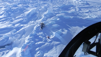 A photograph taken from a search and rescue helicopter shows the snowmobile abandoned by a young boy who died in Labrador in February 2012.