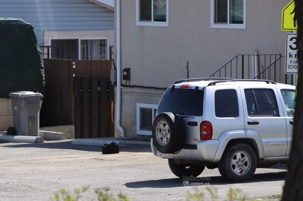 A black bag reported to police as a suspicious package waits in the driveway at 769 York Street for examination by the bomb squad April 30, 2014.