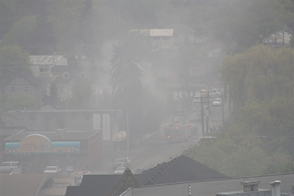 Smoke filled downtown Vernon from a house fire Saturday, May 3, 2014.
