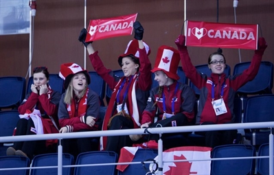 Team Canada women cheer on the mens team in Sochi, Russia earlier this week.