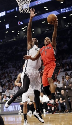 Toronto Raptors' Kyle Lowry (7) drives past Brooklyn Nets' Andray Blatche during the first half of Game 6 of the opening-round NBA basketball playoff series Friday, May 2, 2014, in New York.