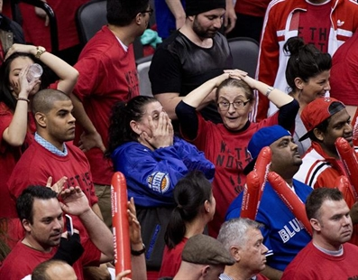Toronto Raptors fans react in the final seconds of the second half of Game 7 of the opening-round NBA basketball playoff series against the Brooklyn Nets in Toronto, Sunday, May 4, 2014.