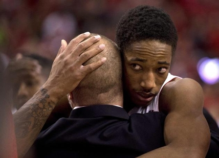 Toronto Raptors guard DeMar DeRozan, right, gets a hug as he walks off the floor after losing to the Brooklyn Nets in Game 7 of the opening-round NBA basketball playoff series in Toronto, Sunday, May 4, 2014.