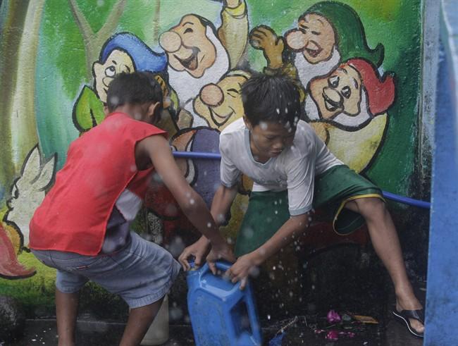 Philippine typhoon kills 3, weakens, as central region